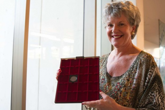 PHOTO: Coin dealer Belinda Downie holding the rare proof penny in Brisbane. (612 ABC Brisbane: Jessica Hinchliffe)